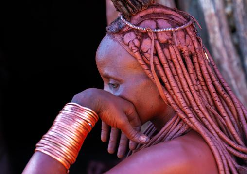 Portrait of a Himba tribe woman wearing bracelets, Cunene Province, Oncocua, Angola