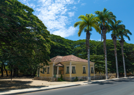 Old portuguese colonial house with palm trees, Namibe Province, Namibe, Angola
