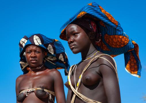 Portrait of a Mucubal tribe women wearing colorful headwears, Namibe Province, Virei, Angola