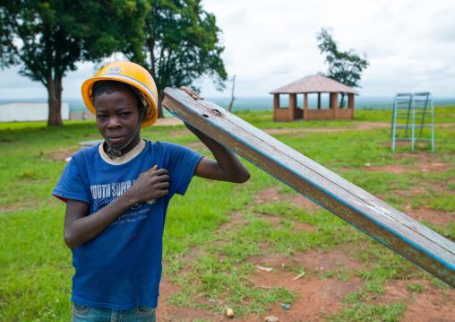 Angolan boy with a yellow safety helmet, Malanje Province, Calandula, Angola