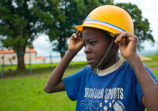 Angolan boy wearing a yellow safety helmet, Malanje Province, Calandula, Angola