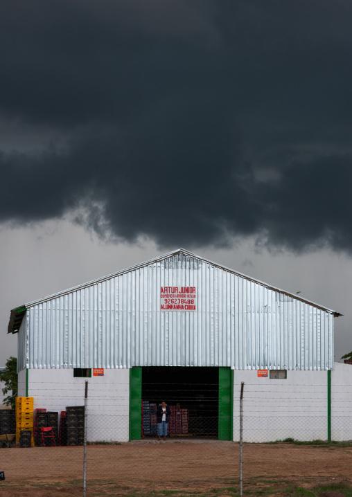 Warehouse under a stormy sky, Huila Province, Chibia, Angola