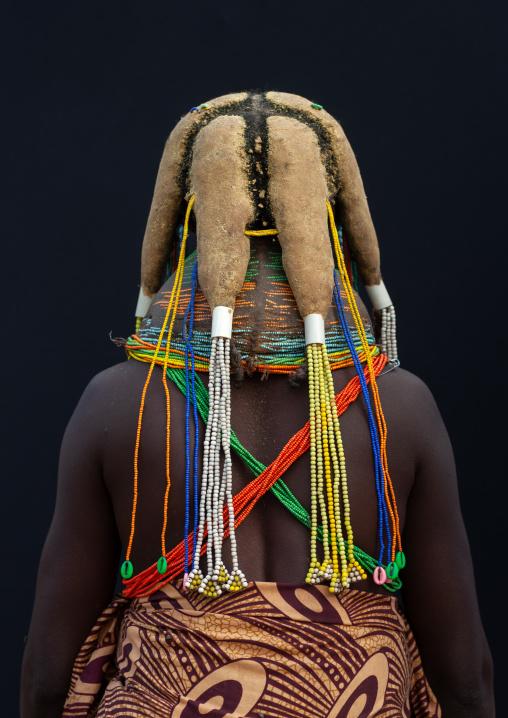 Rear view of a Mumuhuila tribe woman, Huila Province, Chibia, Angola