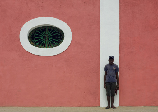 Boy In A Front Of A Pink Facade In Benguela, Angola