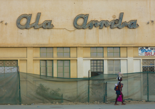 Woman Passing By A Shop With Her Baby On Her Back, Lobito, Angola