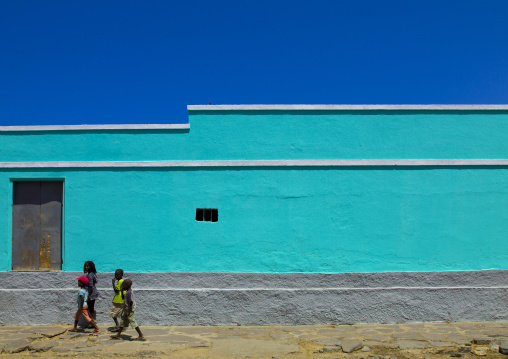 Kids Passing By An Old Colonial Building, Namibe Town, Angola