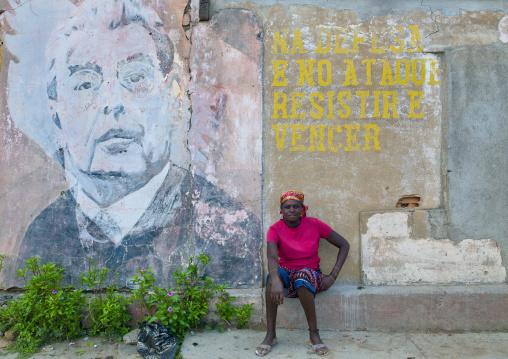 Woman In Front Of An Old Propaganda Wall Painting With Leonid Brejnev, Bilaiambundo Angola