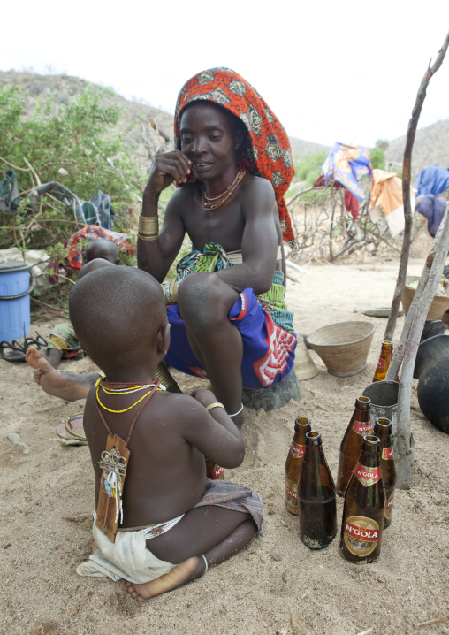 Boy Wearing An Amulet On The Back With His Mother, Virie Area, Angola
