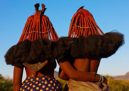 Married himba tribe women rear view, Cunene Province, Oncocua, Angola