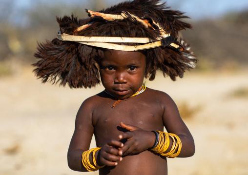 Cute mucubal tribe boy wearing a fur headwear, Namibe Province, Virei, Angola