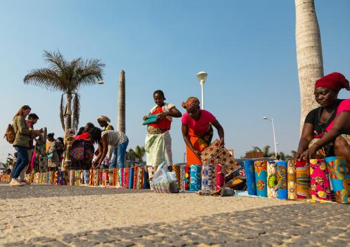 Angolan women selling wax print cloths in a street market, Luanda Province, Luanda, Angola