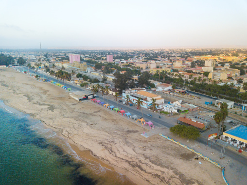 Aerial view of palm trees and umbreallas on Miragens beach, Namibe Province, Namibe, Angola