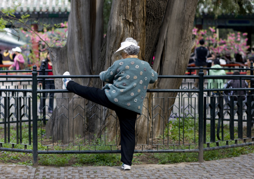 Old Woman Doing Gymnastic In A Park, Beijing, China