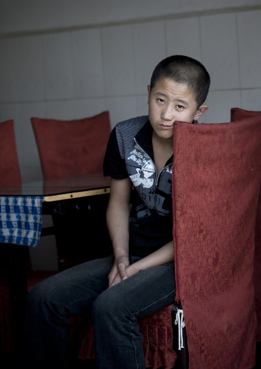 Kid Waiting For The Costumers In A Restaurant, Beijing, China
