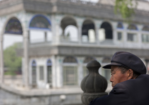 Chinese Man In Front Of Marble Boat In Summer Palace, Beijing China