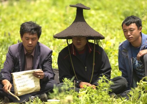 Shaman During A Ceremony, Lugu Lake, Yunnan Province, China