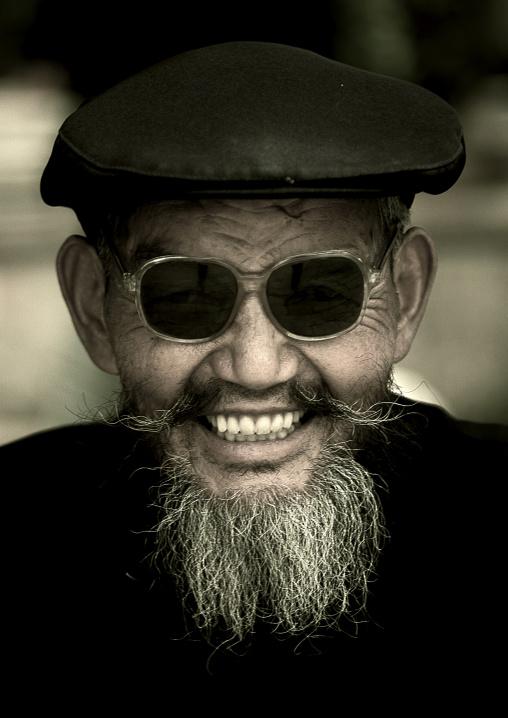Naxi Minority Man Wearing Sunglasses, Lijiang, Yunnan Province, China