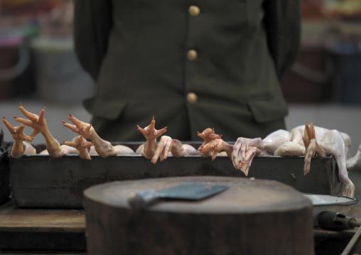 Chicken Seller In A Market, Zhongdian, Yunnan Province, China