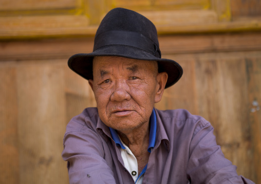 Man Sit In The Street, Bai Village Of Shaxi, Yunnan Province, China
