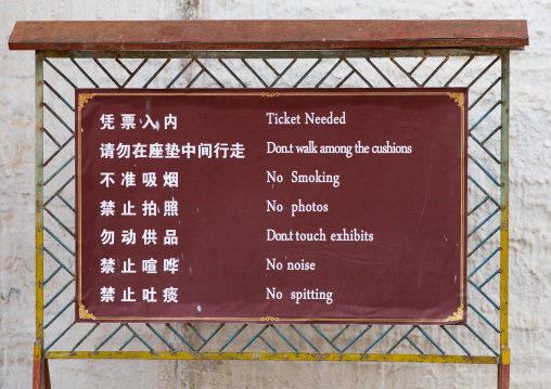 Warning sign outside a temple in Labrang monastery, Gansu province, Labrang, China