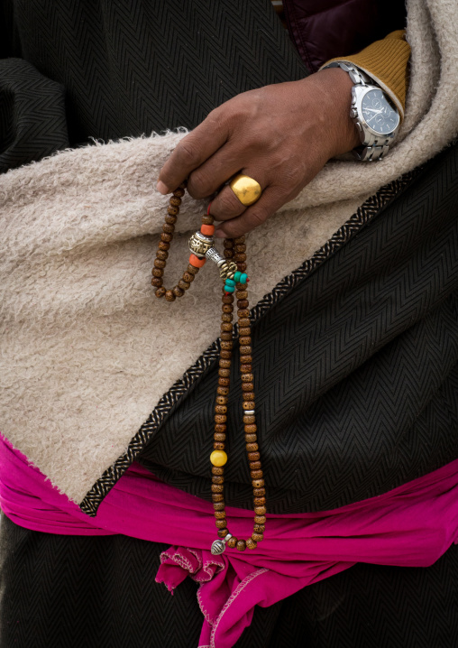 A tibetan pilgrim fingers her prayer beads, Gansu province, Labrang, China