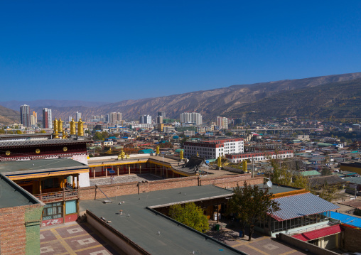 Rongwo monastery in front of the modern town, Tongren County, Longwu, China