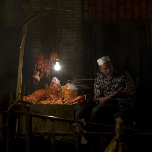 Uyghur Man At His Foodstall In Night Market, Hotan, Xinjiang Uyghur Autonomous Region, China