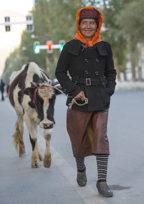 Tajik Woman with her cow , Xinjiang Uyghur Autonomous Region, China