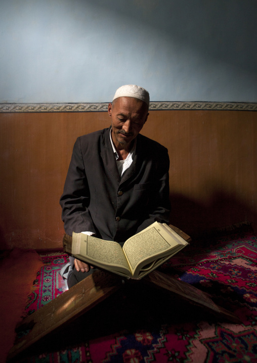 Uyghur Man Studying The Quran, Minfeng, Xinjiang Uyghur Autonomous Region, China