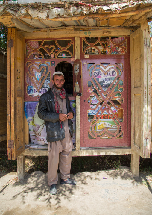 Afganh man selling music and dvd in the market, Badakhshan province, Ishkashim, Afghanistan