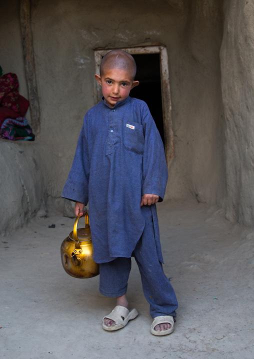 Afghan boy with shaved head, Badakhshan province, Khandood, Afghanistan