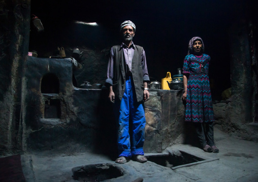 Afghan couple inside their traditional pamiri house, Badakhshan province, Qazi deh, Afghanistan