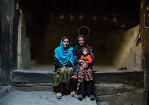 Afghan family inside their traditional pamiri house, Badakhshan province, Zebak, Afghanistan