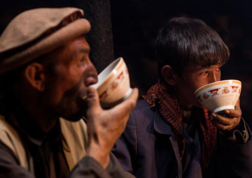 Wakhi men drinking salty milk tea, Big pamir, Wakhan, Afghanistan
