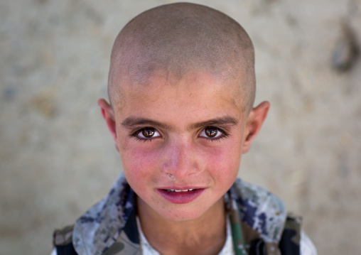 Afghan boy with head shaved, Badakhshan province, Khandood, Afghanistan
