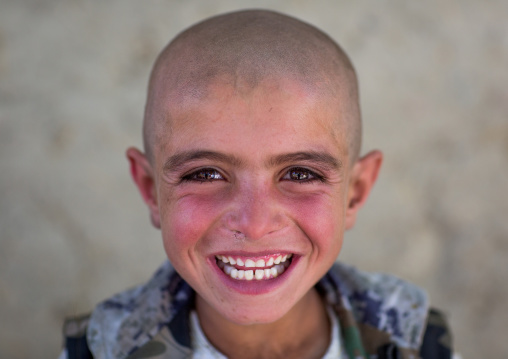 Smiling afghan boy with head shaved, Badakhshan province, Khandood, Afghanistan