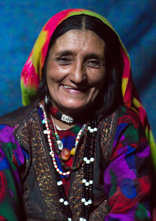 Portrait of a smiling afghan woman in pamiri traditional clothing, Badakhshan province, Khandood, Afghanistan
