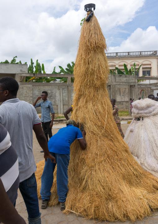 Benin, West Africa, Porto-Novo, man speaking to a zangbetos guardians of the night spirit