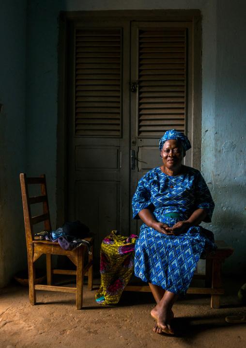 Benin, West Africa, Porto-Novo, old woman in her living room