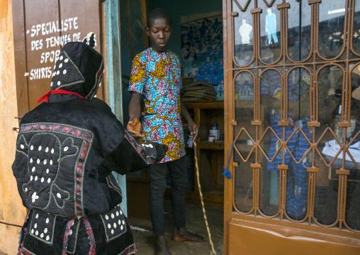 Benin, West Africa, Porto-Novo, egoun egoun spirit of the deads asks money to a taylor in exchange of blessings