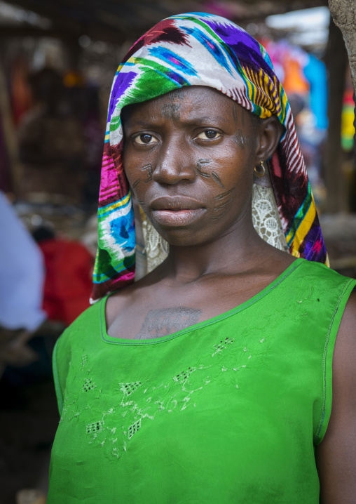Benin, West Africa, Onigbolo Isaba, holi tribe woman covered with traditional facial tattoos and scars