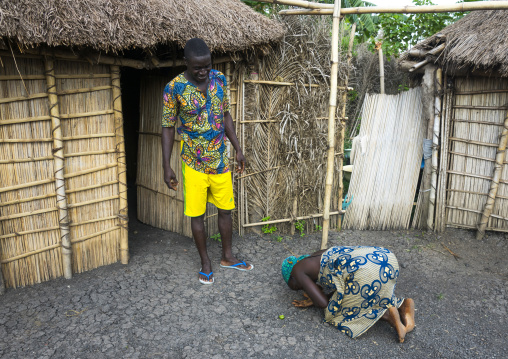 Benin, West Africa, Onigbolo Isaba, holi tribe woman paying respect to her husband in the morning