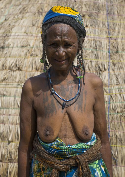 Benin, West Africa, Gossoue, an old tattooed fulani peul woman portrait