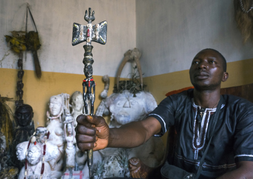 Benin, West Africa, Bonhicon, kagbanon bebe voodoo priest during a ceremony holding a shango stick
