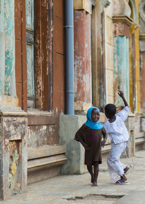 Benin, West Africa, Porto-Novo, children playing along the multicoloured great mosque