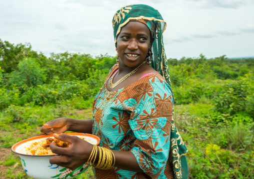 Benin, West Africa, Taneka-Koko, fulani peul tribe woman bringing food for a wedding