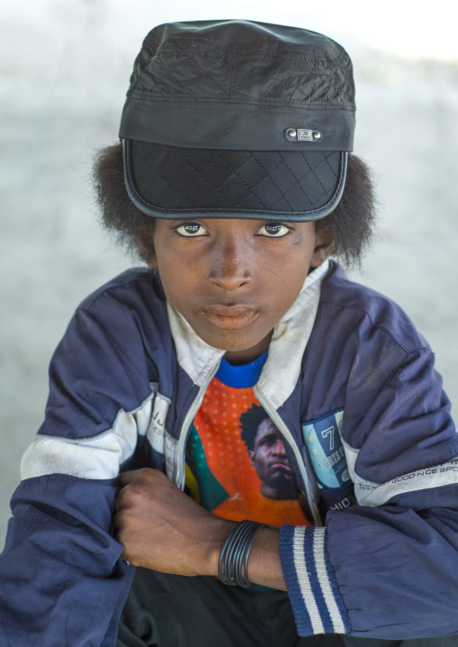 Benin, West Africa, Gossoue, fulani peul tribe boy with fashionable clothes