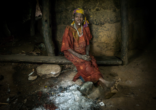 Togo, West Africa, Nadoba, old woman inside a traditional tata somba house