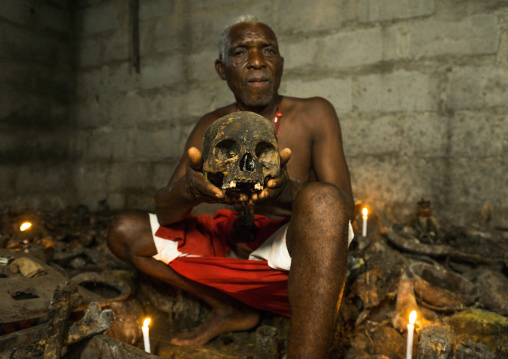 Benin, West Africa, Bopa, dah tofa voodoo master showing the skulls criminals killed by heviosso the god of thunder that he collects