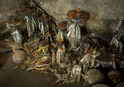 Benin, West Africa, Bopa, voodoo altars covered with oil and blood representing the former masters in a temple